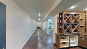 A partial basement with spacious storage area, secondary wine cellar and secure vault room.