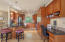 Great design with plenty of granite counter space, breakfast bar and planning desk.