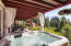 Great hot tub with privacy drapes and a magical setting
