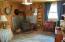 Second main floor bedroom has wood stove.