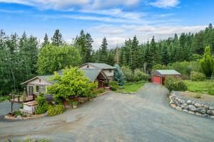 Live the dream with Lake views, 10 acres filled with meadows and trees and a spacious home and SHOP 20-X30 SHOP plus 2 car attached garage.