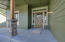 Beautiful front porch with custom front door