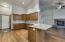Enlarged custom kitchen with eating bar. Solid granite counters.