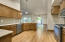 Lots of storage and work spaces in the beautiful kitchen