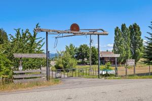 One of a kind 20 acre ranchette right in Harrison just 25 minutes to Coeur d Alene, with lake views and plenty of outbuildings for horses, goats, yaks, llamas, chickens and more.
