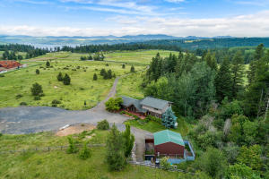 20 beautiful acres available for you with peeks of Coeur d Alene Lake and the mountains. Rare opportunity that includes a 2019 40' Boat slip lease at Rockford Bay Marina . Step into the good life.