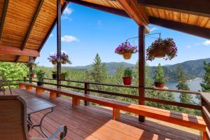 1.66 acre in close-in Coeur d Alene with beautiful remodeled 2660 SF home, 3 bed , 3 full baths, bonus room, SHOP, 2 kitchens and lake views of Beauty Bay. Country living so close to town.
