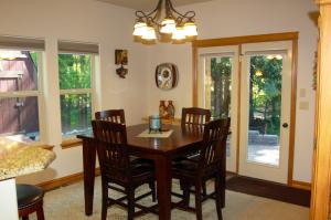 Dining with Doors to Patio