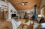 Spacious Living Area and Beautiful Tongue and Groove Vaulted Wood Ceilings.