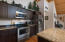 This Kitchen is awaiting your epicurean cuisine.