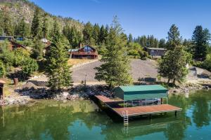 Spectacular setting on 1.19 acres and 100 feet of prime lakefront with covered dock right on stunning Pend O Reille Lake. Over 3100 SF of main floor living, huge Shop and quiet beauty.