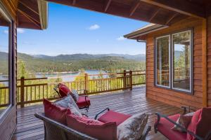 Views of the lake from the covered BBQ deck and large uncovered deck off living spaces