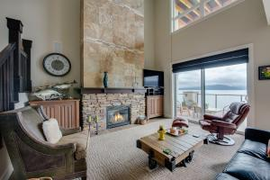 Gorgeous floor to ceiling fireplace commands attention