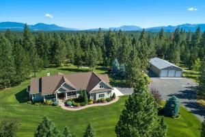 Peace, quiet, timeless design. 3 beds, 3 baths, 3912 sqft + additional 1000 sqft living quarters (w 2 BR and BA) on 10 acres, gated property w/oversized 2 car garage & shop & detached 5-car shop 10 acre serenity.