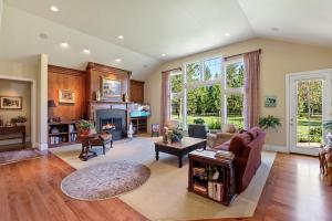 Vaulted ceilings, cherry paneled walls, large open windows with abundant natural light.