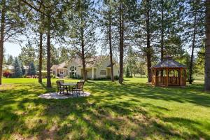 Your own oasis with level 10 acres, gazebo and sitting areas.