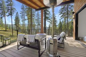 Oversized covered deck allows you to enjoy the beauty of Mica Bay year-round.