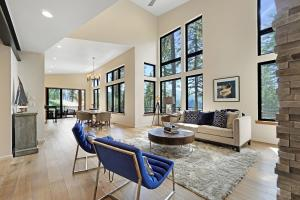 Vaulted ceiling and floor to ceiling windows bring the outside in.