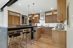 A functional and beautiful gourmet kitchen with built-in Thermador Professional appliances and a large butler's pantry.