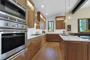 Built in Thermador Professional appliances, quartz counters, full-height designer tile backsplash and solid wood cabinetry with soft close doors/drawers.