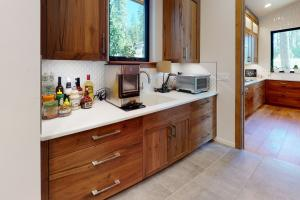 Lots of counter space for additional appliances and prep area with sink.