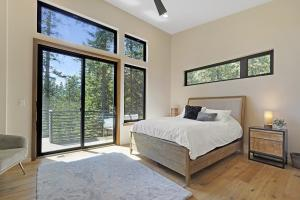 Large master bedroom suite with sliding doors to wrap around deck.