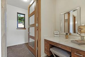 Built in vanity with quartz counter and walk-in closet.