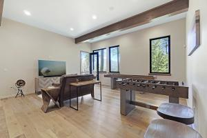 Exposed beams, large windows and dramatic 12 foot ceilings draw your eyes out to the gorgeous Mica Bay views.