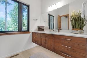 Floating vanity with quartz counter, under cabinet lighting and beautiful views.