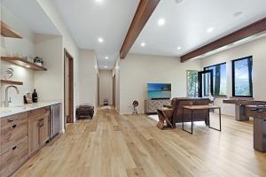 Exposed beams, high ceilings and wide plank wood floors define this flexible space.