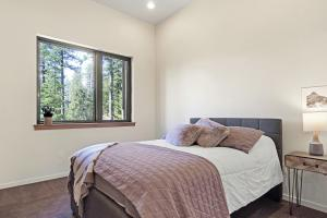 Beautifully finished bedroom off the hallway includes ceiling fan, closet with built-ins and lake views.