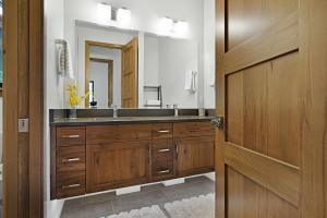 Lots of room for everyone with a dual vanity third bathroom. Quartz counters and under cabinet lighting and pocket door to tub, shower and toilet.