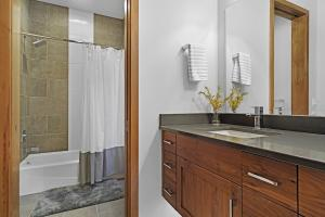 Privacy for multiple users. Pocket door transitions between the vanity area and tub, shower and toilet.