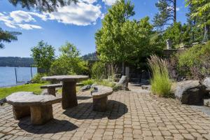 Stone picnic table and large fire pit keep the luxuries of Idaho at your fingertips.