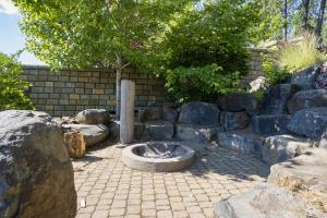 Stone fire pit with boulder seating is perfect for roasting marshmallows and telling tall tales.