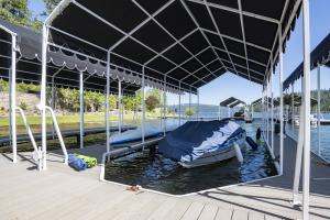 Your personal covered boat slip has ample room for a boat, kayaks and all the toys.