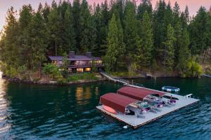 Twilight at The Point of Hayden Lake. Two homes, 4 parcels, 411 Feet of frontage. Private setting. Magical.