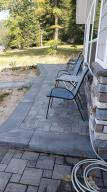 Wrap-around patio with pavers