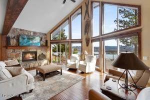 Stunning Lake views in a remodeled 3600 SF 4 bedroom home in gated Harbor View Estates. The great room boasts stunning lake views and is open to the kitchen and loft!