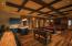 Lower level rec room with soda pop bar, theater, game tables and more.