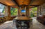 Outdoor living spaces include a full kitchen with built-in pizza oven and grill.