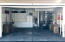 """Oversized 2-car garage """"tricked-out"""" with built-in cabinets & shelving"""
