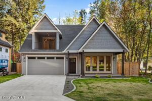 3 Bedrooms, 3 full baths, 2 half baths in this 2364 sq ft home across from the Hayden Lake Country Club