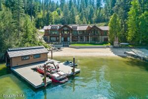 The Deer Run Lakelodge with rare grandfathered boathouse and 156' sandy level beach! A masterpiece on coveted Mica Bay!