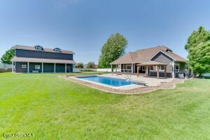 Stunning grounds! Shop, in ground pool and custom home!!! Excellence defined!!!!