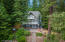 Situated on 2 wooded acres with secondary waterfront access to Carlin Bay Marina on Lake Coeur d'Alene.