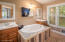 Double vanities, relaxing soaker tub and separate shower