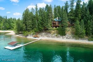 One of the most spectacular homes and settings on Hayden Lake. In Sunset Beach with 132.5' of sandy beach and western sunset views - Stunning 6 bedroom, 8900 SF home!