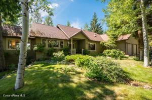 Custom built home located on 414 forested acres of North Idaho paradise. Adjacent to USFS.