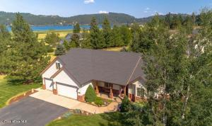 Custom rancher with lakeviews on a 1 acre parcel!